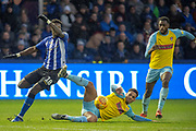 Sheffield Wednesday forward Lucas Joao (18) on his way to score the opening goal 1-0 as Rotherham United defender Zak Vyner slides to try and stop Sheffield Wednesday forward Lucas Joao (18)  during the EFL Sky Bet Championship match between Sheffield Wednesday and Rotherham United at Hillsborough, Sheffield, England on 8 December 2018.
