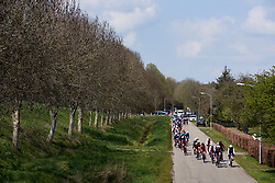The peloton approach on lap three at Healthy Ageing Tour 2019 - Stage 5, a 124.3 km road race in Midwolda, Netherlands on April 14, 2019. Photo by Sean Robinson/velofocus.com