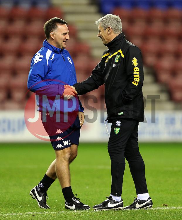 Wigan Athletic manager Warren Joyce greets Norwich  - City coach Alan Irvine - Mandatory by-line: Matt McNulty/JMP - 07/02/2017 - FOOTBALL - DW Stadium - Wigan, England - Wigan Athletic v Norwich City - Sky Bet Championship