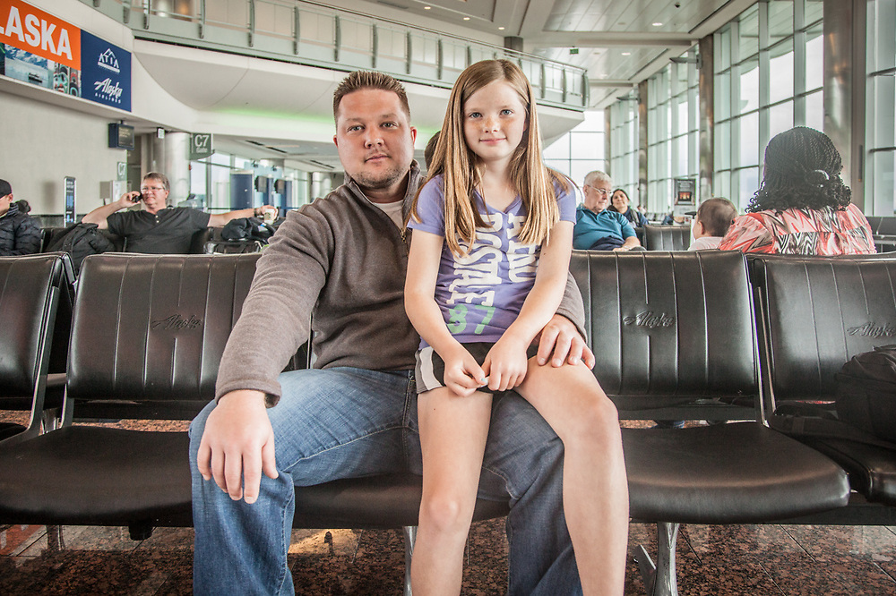 "Leila Kopy (10) with her dad, Chris, at the Anchorage International Airport  ""I want to be a vegetarian when I grow up...I mean a Veterinarian.""  ckopy@live.com"