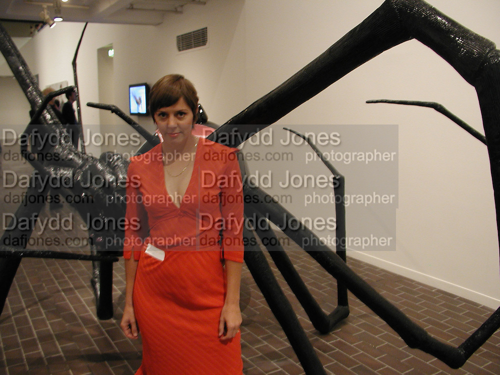 Liz Craft in fron of her work, ' Black Widow'The Americans.-New Art. Barbican. 24 October 2001. © Copyright Photograph by Dafydd Jones 66 Stockwell Park Rd. London SW9 0DA Tel 020 7733 0108 www.dafjones.com