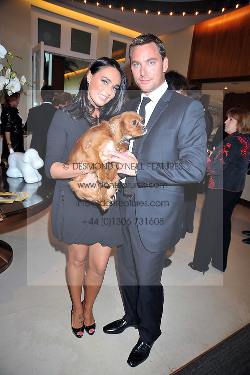 TAMARA ECCLESTONE and ROBERT MONTAGUE with her pet dog at the annual Dog's Trust Honours Awards held at The Hurlingham Club, Fulham, London on 19th May 2009.