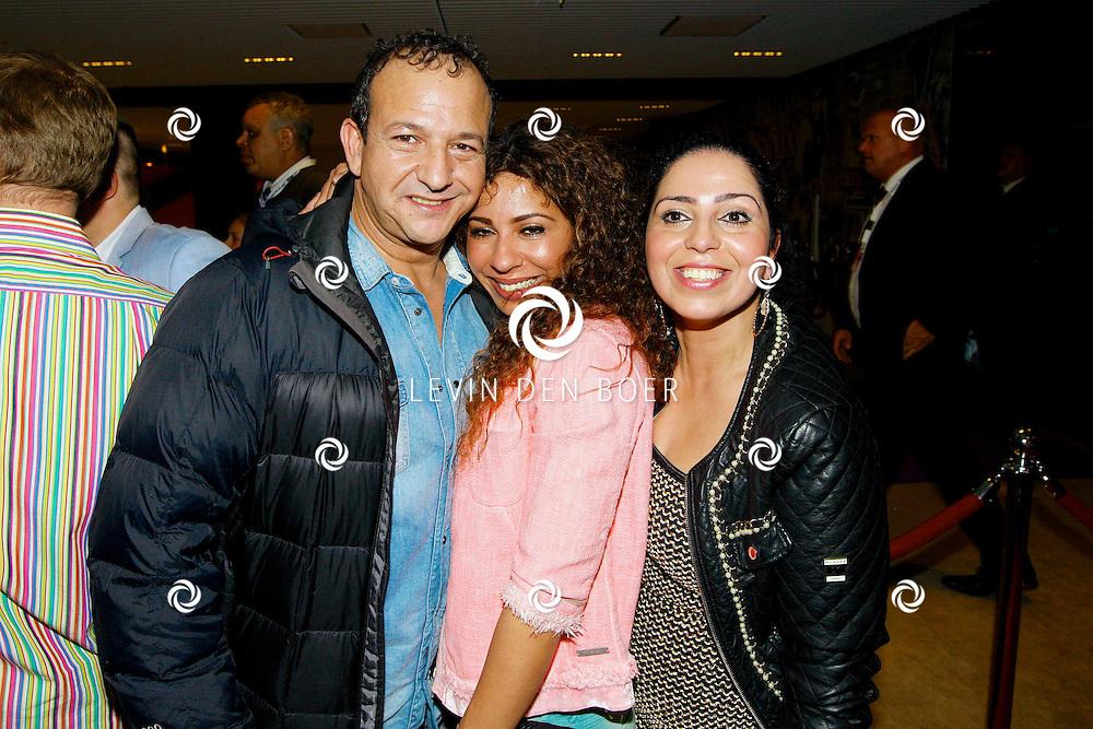 AMSTERDAM - Na het concert van De Toppers is er de welbekende VIP PARTY voor alle bekende Nederlanders. Met hier op de foto  Najib Amhali met vrouw Niama en ???. FOTO LEVIN DEN BOER - PERSFOTO.NU