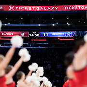 January 9, 2018, New York, NY : The St. John's men's basketball team cheerleaders work to rile up the crowd during Tuesday night's matchup between the Hoyas and Red Storm at the Garden. In something of a rematch of their 1985 contest, Basketball greats Patrick Ewing and Chris Mullin returned to Madison Square Garden on Tuesday night to face off as coaches with their respective Georgetown and St. John's teams.  CREDIT: Karsten Moran for The New York Times