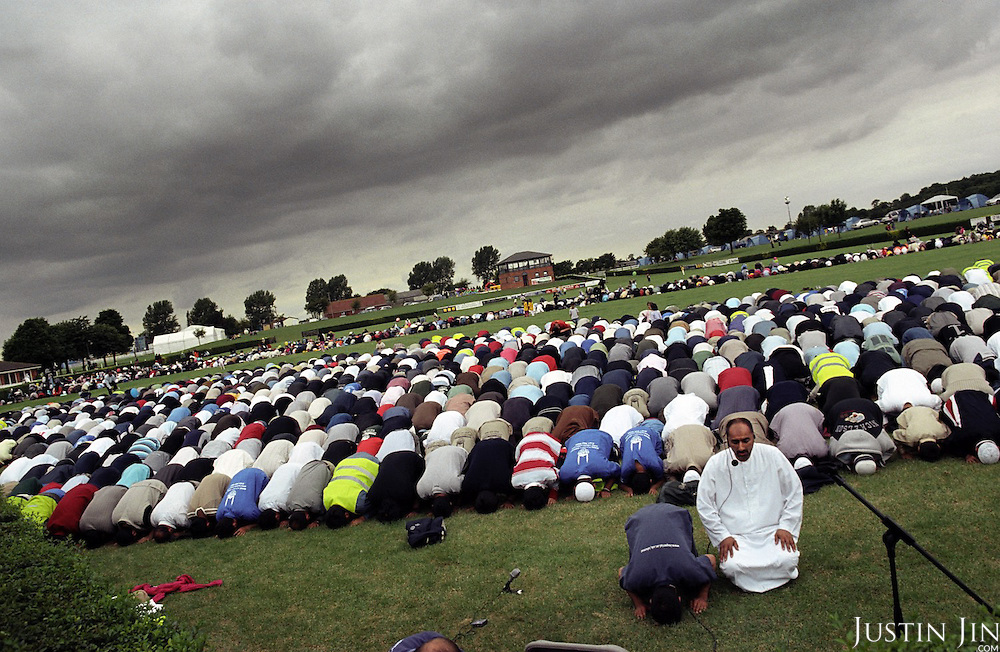 "British Muslims pray at the four-day ""Living Islam"" festival in northern England in July 2005.....The event, attended by thousands of mainly Pakistani Muslims across the UK, takes place in the Showground of Lincoln, one of England's great cathedral cities.....The event was organised by the Islamic Society of Britain and takes place co-incidentally days after the London bombings by purported Islamic extremists. Organisers said the gathering was a symbol of Muslims celebrating the true meaning of Islam.....There were activities for the family including music, entertainment, sports and speeches. .."