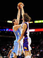 Dec. 22, 2011; Phoenix, AZ, USA; Denver Nuggets center Timofey Mozgov (25) is blocked by the Phoenix Suns center Robin Lopez (15) during the first half of a preseason game at the US Airways Center. Mandatory Credit: Jennifer Stewart-US PRESSWIRE...