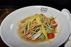 © Licensed to London News Pictures. 10/07/2017. London, UK. A Thai salad is served as Bang Bang Oriental Foodhall celebrates its grand opening in Colindale, north London.  Standing on the site of the former Oriental City, Bang Bang Oriental Foodhall brings stalls offering 27 different Asian cuisines and has modelled on the format of popular food courts in Asia. Photo credit : Stephen Chung/LNP