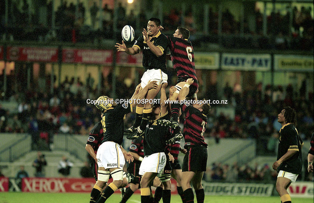 Wellington flanker Jerry Collins secures the lineout ball ahead of Reuben Thorne at the NPC rugby union final between Canterbury and Wellington, on October 21 2000. Wellington won the match 34-29. Photo: Andrew Cornaga/PHOTOSPORT<br />