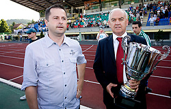 Ales Remih of Olimpija  and Franc Kopatin of NZS with a Cup after final match of 2nd SNL league between NK Olimpija in NK Aluminij, on May 23, 2009, ZAK, Ljubljana, Slovenia. Aluminij won 2:1. NK Olimpija is a Champion of 2nd SNL and thus qualified to 1st Slovenian football league for season 2009/2010. (Photo by Vid Ponikvar / Sportida)