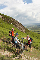 Three cyclists on hill