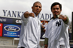 September 10, 2009; Bronx, NY; USA; Manny Pacquiao (r) and Miguel Cotto (l) pose at the press conference at Yankee Stadium announcing their November 14, 2009 fight.  The two will meet at the MGM Grand Garden Arena in Las Vegas, NV.