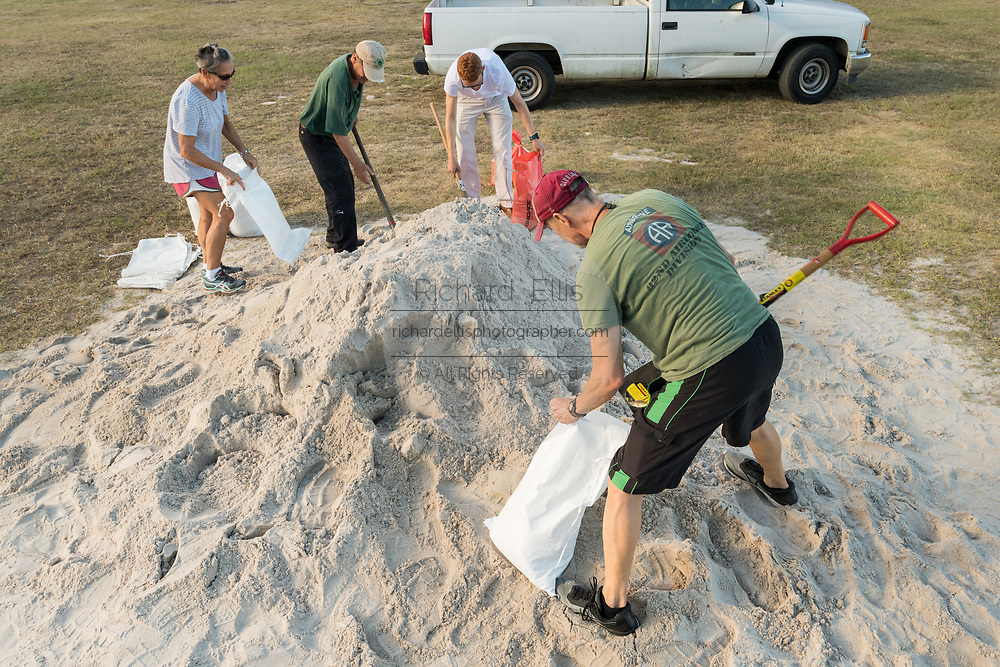 Residents of coastal South Carolina fill sand bags in preparation for approaching Hurricane Florence September 10, 2018 in Mt Pleasant, South Carolina. Florence, a category 4 storm, is expected to hit the coast between South and North Carolina and could be the strongest storm on record for the East Coast of the United States.