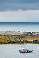 Fishing boat moored of the coast of Isle of Skye looking out to the Minch, Scotland