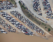 20090922  -  Austell, Ga : Constant rains for nearly a week saturated the metro Atlanta area bringing flood waters to residents' doors, flooding businesses like this auto insurance storage facility and claiming the lives of at least eight by Tuesday, September 22, 2009. Cobb, Carroll, Douglas, DeKalb, Forsyth, Fulton, and Gwinnett County schools were closed because of the floods and resulting treacherous road conditions while business and homes were under water.   David Tulis         dtulis@gmail.com    ©David Tulis 2009