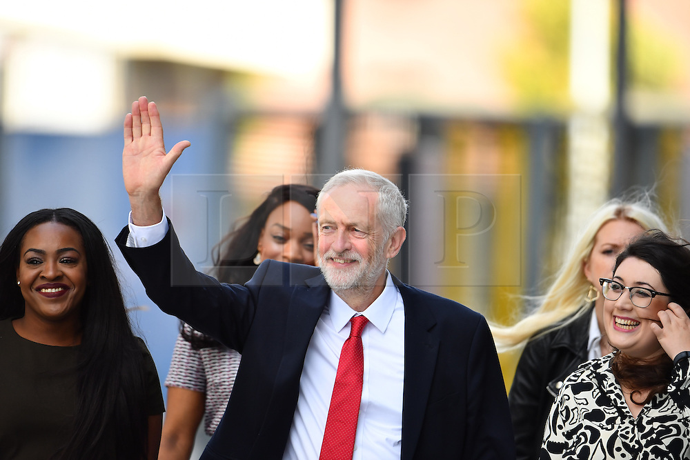 © Licensed to London News Pictures. 28/09/2016. Liverpool, UK. JEREMY CORBYN arrives with young supporters for leaders speech at day four of the Labour Party Annual Conference, held at the ACC in Liverpool, Merseyside, UK. Photo credit: Ben Cawthra/LNP
