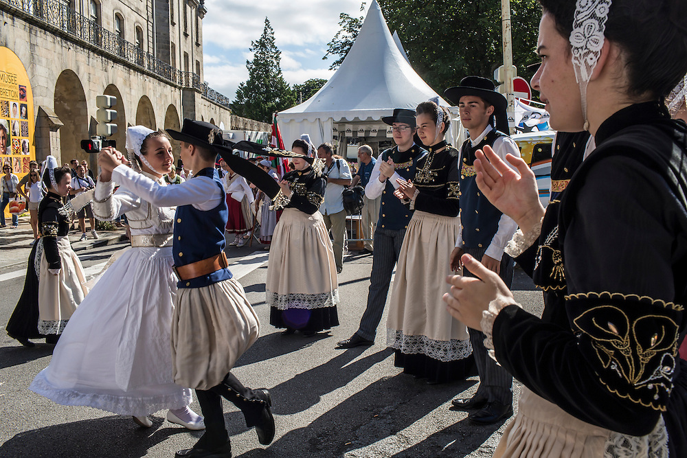 A group in traditional clothing plays traditional music while dancing traditional steps at the Festival de Cornouaille on Saturday, July 23, 2016 in Quimper, France.
