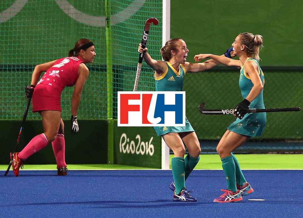 RIO DE JANEIRO, BRAZIL - AUGUST 13:  Emily Smith of Australia celebrates with team mate Gabi Nance (R) after scoring their second goal during the Women's Pool B hockey match between Australia and Japan on Day 8 of the Rio 2016 Olympic Games at the Olympic Hockey Centre on August 13, 2016 in Rio de Janeiro, Brazil.  (Photo by David Rogers/Getty Images)