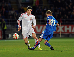 Gareth Bale of Wales (Real Madrid) is challenged by Hallfredsson of Iceland  - Photo mandatory by-line: Dougie Allward/JMP - Tel: Mobile: 07966 386802 03/03/2014 -