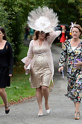 Guest arrive for the Former Prime Minister Tony Blair's Son Euan Blair Wedding to Suzanne Ashman at All Saints Church in  Wotton Underwood, United Kingdom. Saturday, 14th September 2013. Picture by Ben Stevens / i-Images<br /> <br /> Picture are guests arriving at the wedding.