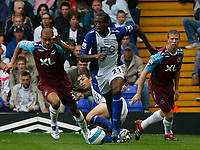 Photo: Steve Bond.<br />Birmingham City v West Ham United. The FA Barclays Premiership. 18/08/2007. Olivier Kapo (C) comes away with the ball with Keiron Dyer (L) in pursuit