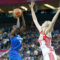 09 August 2012: France Emilie Gomis takes a jumpshot over Russia Natalya Vieru during 81-64 Team France victory over Team Russia, during the women's basketball semi-finals, at the 02 Arena, in London, Great Britain.