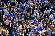 Golden State Warriors fans celebrate guard Klay Thompson (11) 60 points in three quarters against the Indiana Pacers at Oracle Arena in Oakland, Calif., on December 5, 2016. (Stan Olszewski/Special to S.F. Examiner)