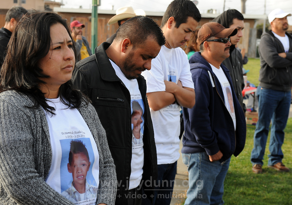 "Friends and family of Azahel Cruz listen during Sunday's ""100 Mothers Vigil"" in Salinas. The 6-year-old was struck in the head and killed by a stray bullet during a nearby gang shootout on March 23rd, 2010."