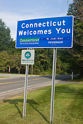 """CT state welcome sign that reads """"Connecticut Welcomes You""""."""