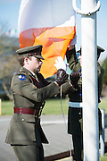 15/03/2016 Capt Damien Kelleher from Renmore Army Barracks raising the Tricolour from Feargal Barry President GMIT at the GMIT on Proclamation day. Photo:Andrew Downes, xposure.