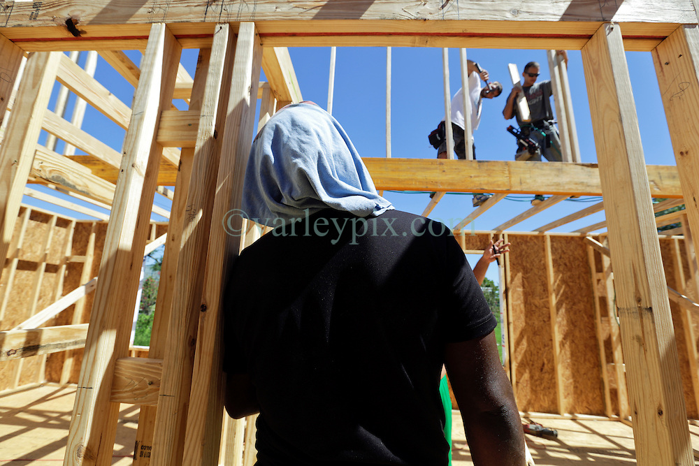 26 August 2015. New Orleans, Louisiana. <br /> Hurricane Katrina revisited. <br /> Rebuilding the Lower 9th Ward. <br /> Another eco friendly 'Make it Right' house on Tennessee Street takes shape.  'Make it Right' homes inspired by actor Brad Pitt continue to provide hope for the rebirth of the community following the devastation of hurricane Katrina a decade earlier.<br /> Photo credit©; Charlie Varley/varleypix.com.