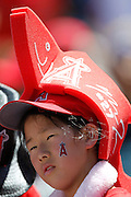 ANAHEIM, CA - AUGUST 12:  A young fan of the Los Angeles Angels of Anaheim wars a foam hat in support of her team before the game against the Seattle Mariners on Sunday, August 12, 2012 at Angel Stadium in Anaheim, California. The Mariners won the game 4-1. (Photo by Paul Spinelli/MLB Photos via Getty Images)