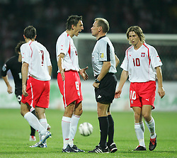 WARSAW, POLAND - WEDNESDAY, SEPTEMBER 7th, 2005: Poland's Jacek Bak argues with referee Claus Larsen during the World Cup Group Six Qualifying match against Wales at the Legia Stadium. (Pic by David Rawcliffe/Propaganda)