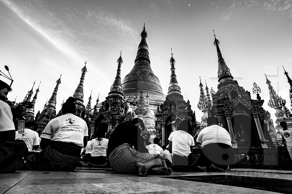 Worshipers in front of Shwedagon Pagoda, Yangon, Myanmar, Asia