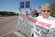Aug. 8, 2009 -- SCOTTSDALE, AZ: DOTTIE KENNARD (RIGHT) from Peoria, AZ, and GREGORY WIRTH, from Scottsdale, protest against the Obama health care plan. Nearly 1,000 people opposed to the President Barack Obama's health care reform efforts picketed the offices of Congresman Harry Mitchell (D-AZ) in Scottsdale, AZ, Saturday. The protest was organized by conservative groups who are organizing similar protests against President Obama across the US. Ostensibly concerned mostly with health care reform, it was also a protest against almost everything related to the Obama administration. Photo by Jack Kurtz / ZUMA Press