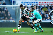 Newcastle United forward Aleksandar Mitrovic (#45) holds off the challenge of Derby County defender Richard Keogh (#6) during the EFL Sky Bet Championship match between Newcastle United and Derby County at St. James's Park, Newcastle, England on 4 February 2017. Photo by Craig Doyle.