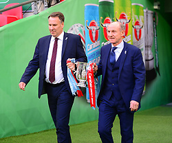 EX ARSENAL PLAYER PAUL MERSON AND EX MANCHETER CITY PLAYER DENNIS TUEART BRING OUT THE 2018 CARABAO CUP, Arsenal v Manchester City Carabao League Cup Final, Wembley Stadium, Sunday 25th February 2018, Score Arsenal 0- Man City 3.