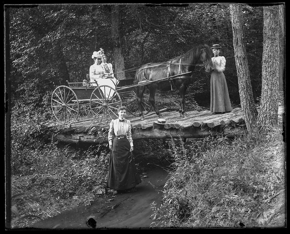 Victorian photograph of women with a horse and carriage crossing over a bridge in Fallston, Maryland.