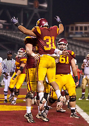 Dec 26, 2009; San Francisco, CA, USA;  Southern California Trojans fullback Stanley Havili (31) celebrates after scoring a touchdown during the second quarter against the Boston College Eagles at the 2009 Emerald Bowl at AT&T Park.  USC defeated BC 24-13.