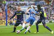 Brighton and Hove Albion midfielder Solomon (Solly) March (20) battles with \Everton striker Wayne Rooney (10) and Everton midfielder Idrissa Gueye (17) during the Premier League match between Brighton and Hove Albion and Everton at the American Express Community Stadium, Brighton and Hove, England on 15 October 2017. Photo by Phil Duncan.
