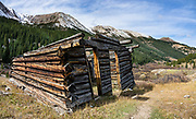 Historic late-1800s log cabin. Independence has been a ghost town since about 1899, when trains came into Aspen and the gold played out. Supposedly founded on Independence Day July 4, 1879 when gold was discovered, Independence was the first community in the Roaring Fork River Valley, a tributary of the Colorado River. Independence lies in a harsh environment at 10,830 feet elevation, 13.5 miles east of Aspen on Highway 82, and four miles west of Independence Pass on the Continental Divide, in Pitkin County, Colorado, USA. The remaining buildings are on land near the river owned by the Loughren Trust, and the upper site is in White River National Forest. In its short life, few could agree on a name for Independence, which was also known as Farwell, Chipeta City, Sparkill, Mammoth Mountain, Mount Hope, and Hunter's Pass. This image was stitched from multiple overlapping photos.