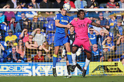 AFC Wimbledon defender Will Nightingale (5) beating Southend United striker Nile Ranger (50) to the ball during the EFL Sky Bet League 1 match between AFC Wimbledon and Southend United at the Cherry Red Records Stadium, Kingston, England on 25 March 2017. Photo by Matthew Redman.