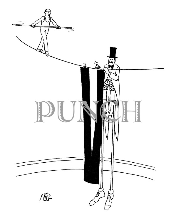 A stilt walker in a circus hangs his trousers to dry on a tightrope walker's line)