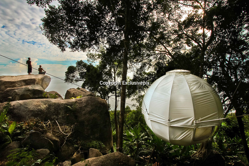 Amazing Cocoon Bed! <br /> Man goes back to nature that's today's reality ! Tree houses are successfull but they are very expensive to build, on cannot undo them. The Concept forCocoon Tree: a very light sphere (140Kgs ) made of high density aluminium tubes, coveredy a strong canvas which can be installed in trees within 2 hours. A second « skin » made of synthetic fiber looking like bambou can be added. Inside a huge bed of 2,40m diameter, a generous space with 3 larges openings. It is the brainchild of Frenchman Berni Du Payrat, who says he was inspired to create it after looking at an ostrich egg, and costs between 3,700 euros and 11,000 euros. The Cocoon Bed is made of aluminium and weighs only 130 pounds. It is rigged up with ropes and secured by nets and can hold the weight of up to a tonne. <br /> ©Exclusivepix