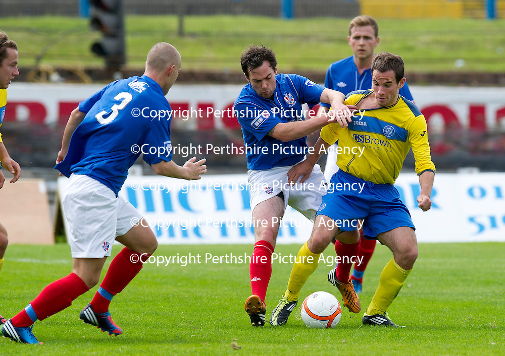 Cowdenbeath v St Johnstone....21.07.12  pre-season friendly<br /> Kevin Moon gets his shirt pulled by Jamie Stevenson<br /> Picture by Graeme Hart.<br /> Copyright Perthshire Picture Agency<br /> Tel: 01738 623350  Mobile: 07990 594431