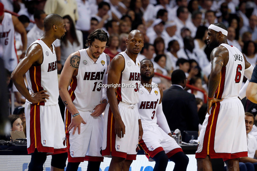 Jun 18, 2013; Miami, FL, USA; Miami Heat center Chris Bosh (left), Miami Heat shooting guard Mike Miller (13), shooting guard Ray Allen (34), shooting guard Dwyane Wade (3), and small forward LeBron James (6) wait during a time out during the first quarter of game six in the 2013 NBA Finals against the San Antonio Spurs at American Airlines Arena.  Mandatory Credit: Derick E. Hingle-USA TODAY Sports