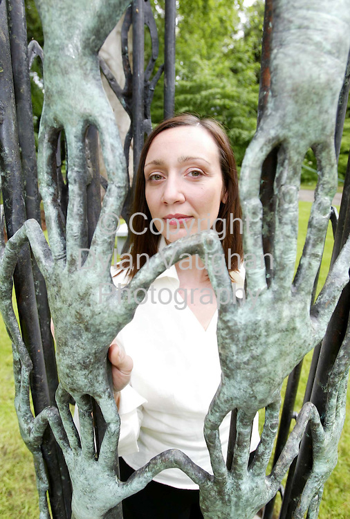 25/5/2002 Sunday Independent.Ann Mulrooney pictured with her sculpture of hands in the Castle Park in Kilkenny..Picture Dylan Vaughan