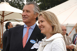 ARNAUD BAMBERGER MD of Cartier and his wife CARLA at the Cartier International polo at Guards Polo Club, Windsor Great Park on 29th July 2007.<br />