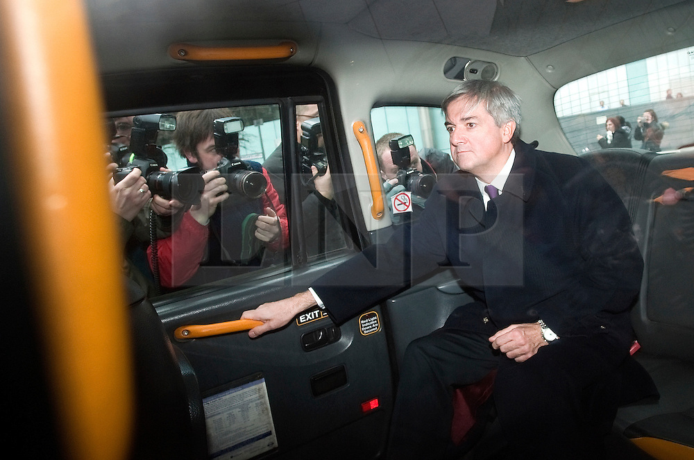© Licensed to London News Pictures. 02/03/2012. London, UK. Liberal Democrat MP CHRIS HUHNE leaving Southwark Crown Court in a taxi on March 2nd, 2012 where he faced charges of perverting the course of justice. Former Energy Secretary CHRIS HUHNE is accused of asking his ex-wife VICKY PRYCE to take speeding points on his behalf in 2003. Photo credit : Ben Cawthra/LNP