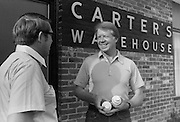 Jimmy Carter and his brother Billy outside the office of the family business - Carter's Warehouse - in Plains, Georgia.