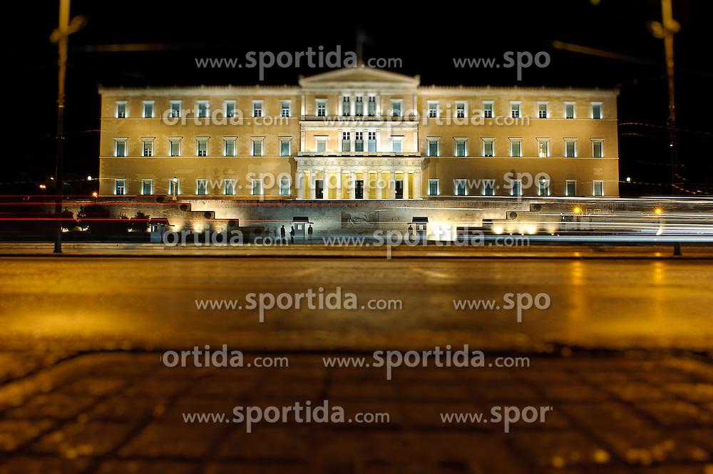 THEMENBILD - Finanzkrise in Griechenland. Bild zeigt das Parlament in Athen bei Nacht, im Vordergrund der Platz Syntagma. Aufgenommen am 28/09/2011. Bild wurde digital veraendert. EXPA Pictures © 2011, PhotoCredit: EXPA/ S. Zangrando